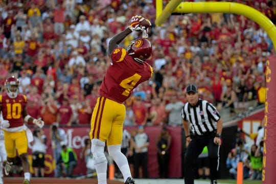 Sep 9, 2017; Los Angeles, CA, USA; USC Trojans wide receiver Steven Mitchell Jr. (4) catches  a touchdown pass during a NCAA football game against the Stanford Cardinal at Los Angeles Memorial Coliseum. Mandatory Credit: Kirby Lee-USA TODAY Sports