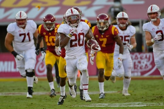 Sep 9, 2017; Los Angeles, CA, USA; Stanford Cardinal running back Bryce Love (20) rushes against the USC Trojans during a NCAA football game at Los Angeles Memorial Coliseum. Mandatory Credit: Kirby Lee-USA TODAY Sports