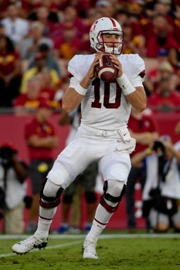 Sep 9, 2017; Los Angeles, CA, USA; Stanford Cardinal quarterback Keller Chryst (10) looks to pass against the USC Trojans during a NCAA football game at Los Angeles Memorial Coliseum. Mandatory Credit: Kirby Lee-USA TODAY Sports