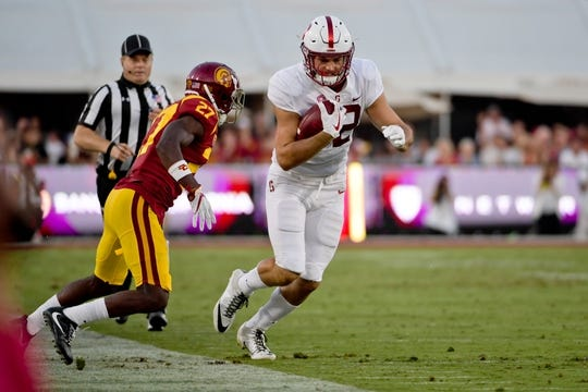Sep 9, 2017; Los Angeles, CA, USA; Stanford Cardinal tight end Kaden Smith (82) after catching a pass against USC Trojans cornerback Ajene Harris (27) during a NCAA football game at Los Angeles Memorial Coliseum. Mandatory Credit: Kirby Lee-USA TODAY Sports