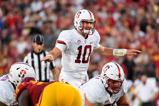 Sep 9, 2017; Los Angeles, CA, USA; Stanford Cardinal quarterback Keller Chryst (10) makes the call at the line against the USC Trojans during a NCAA football game at Los Angeles Memorial Coliseum. Mandatory Credit: Kirby Lee-USA TODAY Sports