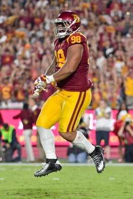 Sep 9, 2017; Los Angeles, CA, USA; USC Trojans defensive tackle Josh Fatu (98) reacts after sacking Stanford Cardinal quarterback Keller Chryst (10) during a NCAA football game at Los Angeles Memorial Coliseum. Mandatory Credit: Kirby Lee-USA TODAY Sports