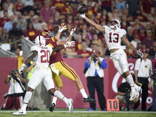 Sep 9, 2017; Los Angeles, CA, USA; Stanford Cardinal cornerback Alijah Holder (13) intercepts a pass intended for Southern California Trojans tight end Tyler Petite (82) during the third quarter at Los Angeles Memorial Coliseum. Mandatory Credit: Kelvin Kuo-USA TODAY Sports