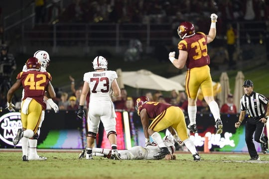 Sep 9, 2017; Los Angeles, CA, USA; Southern California Trojans defensive tackle Josh Fatu (98) sacks Stanford Cardinal quarterback Keller Chryst (10) during the third quarter at Los Angeles Memorial Coliseum. Mandatory Credit: Kelvin Kuo-USA TODAY Sports