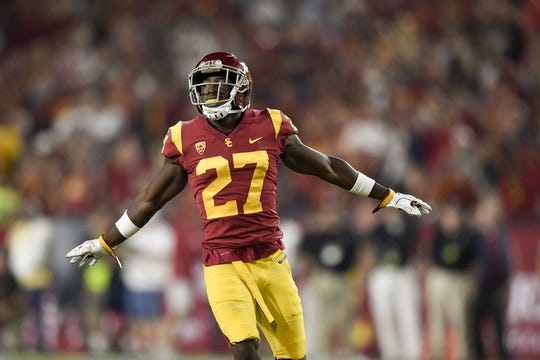 Sep 9, 2017; Los Angeles, CA, USA; Southern California Trojans cornerback Ajene Harris (27) reacts against the Stanford Cardinal during the third quarter at Los Angeles Memorial Coliseum. Mandatory Credit: Kelvin Kuo-USA TODAY Sports