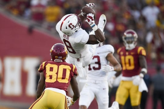 Sep 9, 2017; Los Angeles, CA, USA; Stanford Cardinal safety Justin Reid (8) intercepts the ball ahead of Southern California Trojans wide receiver Deontay Burnett (80) during the second quarter at Los Angeles Memorial Coliseum. Mandatory Credit: Kelvin Kuo-USA TODAY Sports
