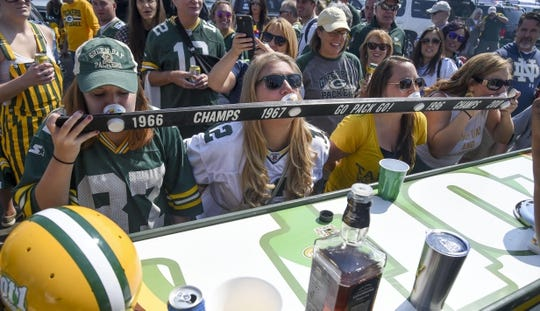 Sep 10, 2017; Green Bay, WI, USA;  Fans drink shots before a game between the Green Bay Packers and Seattle Seahawks at Lambeau Field. Mandatory Credit: Benny Sieu-USA TODAY Sports