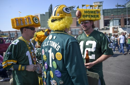Sep 10, 2017; Green Bay, WI, USA;  Travis Chase (left), Greg Jeuss (center) and Jeff Kahlow (right) get ready for game between the Seattle Seahawks and Green Bay Packers at Lambeau Field. Mandatory Credit: Benny Sieu-USA TODAY Sports