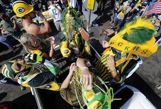 Sep 10, 2017; Green Bay, WI, USA; Fans tailgate before a game between the Seattle Seahawks and Green Bay Packers at Lambeau Field. Mandatory Credit: William Glasheen/The Post-Crescent via USA TODAY Sports