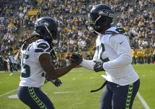 Sep 10, 2017; Green Bay, WI, USA;  Seattle Seahawks defensive end Michael Bennett (72) is greeted by cornerback Richard Sherman (25) before the game against the Green Bay Packers at Lambeau Field. Mandatory Credit: Benny Sieu-USA TODAY Sports