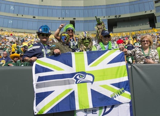 Sep 10, 2017; Green Bay, WI, USA; Seattle Seahawks fans cheer prior to the game against the Green Bay Packers at Lambeau Field. Mandatory Credit: Jeff Hanisch-USA TODAY Sports
