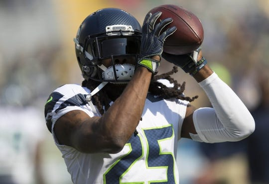 Sep 10, 2017; Green Bay, WI, USA; Seattle Seahawks cornerback Richard Sherman (25) catches a pass during warmups prior to the game against the Green Bay Packers at Lambeau Field. Mandatory Credit: Jeff Hanisch-USA TODAY Sports