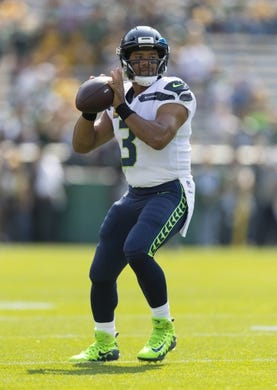 Sep 10, 2017; Green Bay, WI, USA; Seattle Seahawks quarterback Russell Wilson (3) throws a pass during warmups prior to the game against the Green Bay Packers at Lambeau Field. Mandatory Credit: Jeff Hanisch-USA TODAY Sports