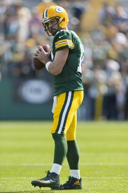 Sep 10, 2017; Green Bay, WI, USA; Green Bay Packers quarterback Aaron Rodgers (12) throws a pass during warmups prior to the game against the Seattle Seahawks at Lambeau Field. Mandatory Credit: Jeff Hanisch-USA TODAY Sports
