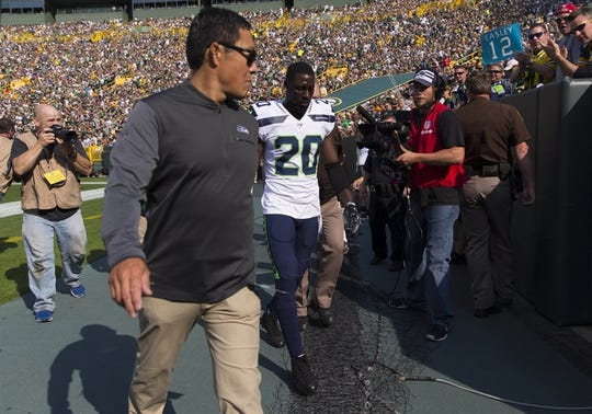 Sep 10, 2017; Green Bay, WI, USA; Seattle Seahawks cornerback Jeremy Lane (20) is escorted from the field after being ejected from the game during the first quarter against the Green Bay Packers at Lambeau Field. Mandatory Credit: Jeff Hanisch-USA TODAY Sports