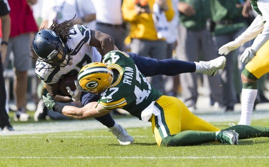 Sep 10, 2017; Green Bay, WI, USA; Green Bay Packers linebacker Jake Ryan (47) tackles Seattle Seahawks running back Eddie Lacy (27) during the first quarter at Lambeau Field. Mandatory Credit: Jeff Hanisch-USA TODAY Sports