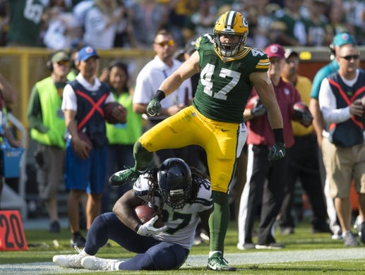 Sep 10, 2017; Green Bay, WI, USA; Green Bay Packers linebacker Jake Ryan (47) steps over Seattle Seahawks running back Eddie Lacy (27) following a tackle during the first quarter at Lambeau Field. Mandatory Credit: Jeff Hanisch-USA TODAY Sports