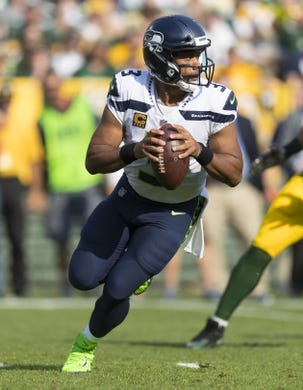 Sep 10, 2017; Green Bay, WI, USA; Seattle Seahawks quarterback Russell Wilson (3) looks to pass during the second quarter against the Green Bay Packers at Lambeau Field. Mandatory Credit: Jeff Hanisch-USA TODAY Sports
