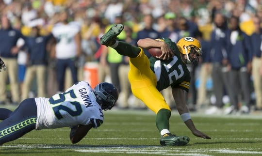 Sep 10, 2017; Green Bay, WI, USA; Seattle Seahawks linebacker Terence Garvin (52) tackles Green Bay Packers quarterback Aaron Rodgers (12) during the second quarter at Lambeau Field. Mandatory Credit: Jeff Hanisch-USA TODAY Sports