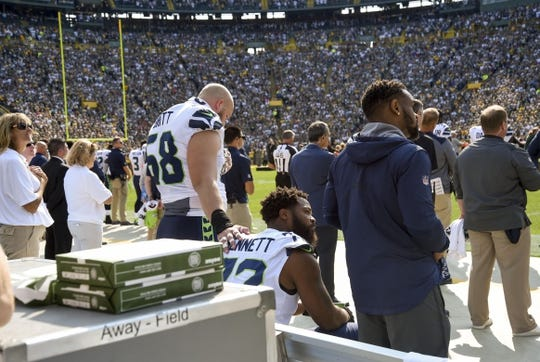Sep 10, 2017; Green Bay, WI, USA;  Seattle Seahawks defensive end Michael Bennett (72) sits on the bench during the national anthem before a game against the Green Bay Packers at Lambeau Field. Mandatory Credit: Benny Sieu-USA TODAY Sports