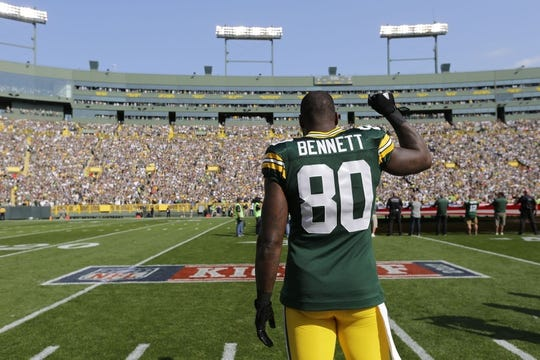 Sep 10, 2017; Green Bay, WI, USA; Green Bay Packers tight end Martellus Bennett raises his arm during the national anthem before the game against the Seattle Seahawks at Lambeau Field. Mandatory Credit: Dan Powers/The Post-Crescent via USA TODAY Sports