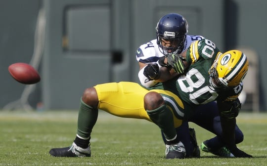 Sep 10, 2017; Green Bay, WI, USA; Green Bay Packers tight end Martellus Bennett (80) can't make a catch against Seattle Seahawks defender Bobby Wagner (54)  in a NFL game at Lambeau Field. Mandatory Credit: Dan Powers/The Post-Crescent via USA TODAY Sports