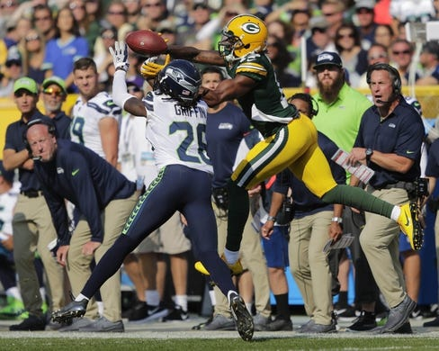 Sep 10, 2017; Green Bay, WI, USA; Green Bay Packers player Davante Adams (17) can't make the catch against Seattle Seahawks player Shaquill Griffin (26)  in a NFL game at Lambeau Field. Mandatory Credit: Dan Powers/The Post-Crescent via USA TODAY Sports