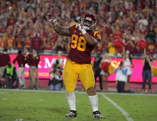 Sep 9, 2017; Los Angeles, CA, USA; Southern California Trojans defensive tackle Josh Fatu (98) celebrates after a sack against the Stanford Cardinal during a NCAA football game at Los Angeles Memorial Coliseum. Mandatory Credit: Kirby Lee-USA TODAY Sports