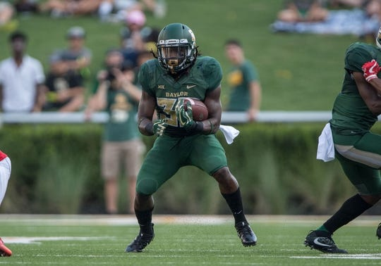 Sep 2, 2017; Waco, TX, USA; Baylor Bears running back JaMycal Hasty (33) in action during the game against the Liberty Flames at McLane Stadium. The Flames defeat the Bears 48-45. Mandatory Credit: Jerome Miron-USA TODAY Sports