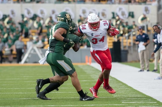 Sep 2, 2017; Waco, TX, USA; Baylor Bears safety Blake Lynch (21)  and Liberty Flames running back Carrington Mosley (34) in action during the game at McLane Stadium. The Flames defeat the Bears 48-45. Mandatory Credit: Jerome Miron-USA TODAY Sports