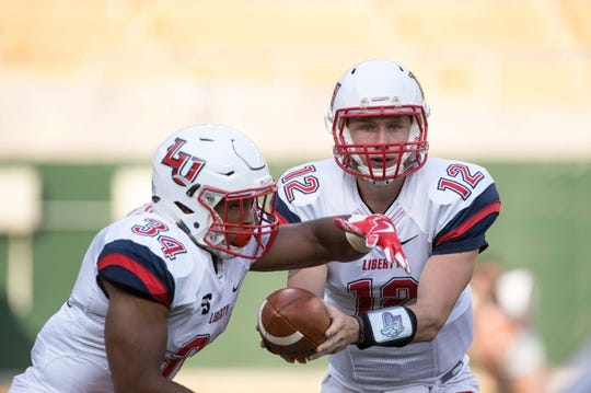 Sep 2, 2017; Waco, TX, USA; Liberty Flames running back Carrington Mosley (34) and quarterback Stephen Calvert (12) in action during the game against the Baylor Bears at McLane Stadium. The Flames defeat the Bears 48-45. Mandatory Credit: Jerome Miron-USA TODAY Sports