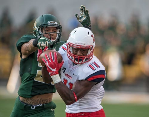 Sep 2, 2017; Waco, TX, USA; Baylor Bears safety Blake Lynch (21)  and Liberty Flames wide receiver Antonio Gandy-Golden (11) in action during the game at McLane Stadium. The Flames defeat the Bears 48-45. Mandatory Credit: Jerome Miron-USA TODAY Sports