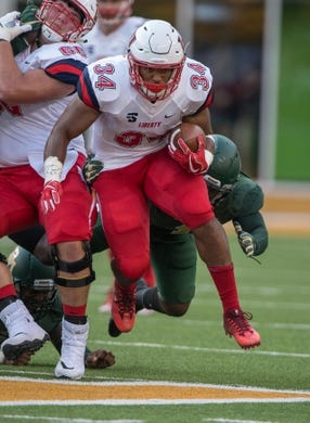 Sep 2, 2017; Waco, TX, USA; Liberty Flames running back Carrington Mosley (34) in action during the game against the Baylor Bears at McLane Stadium. The Flames defeat the Bears 48-45. Mandatory Credit: Jerome Miron-USA TODAY Sports