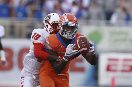 Sep 14, 2017; Boise, ID, USA; Boise State Broncos wide receiver Cedrick Wilson (1) makes a catch as New Mexico Lobos defensive back Elijah Lilly (19) defends during the first half at Albertsons Stadium. Mandatory Credit: Brian Losness-USA TODAY Sports