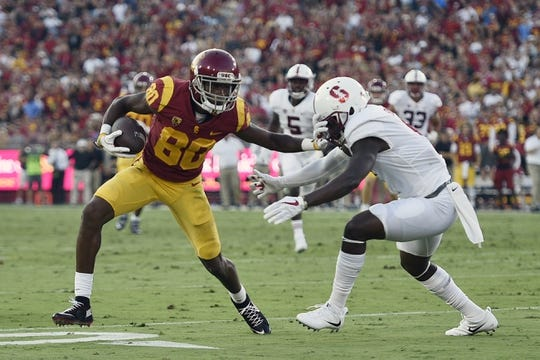 Sep 9, 2017; Los Angeles, CA, USA; Southern California Trojans wide receiver Deontay Burnett (80) runs the ball under pressure by Stanford Cardinal safety Ben Edwards (9) during the second quarter at Los Angeles Memorial Coliseum. Mandatory Credit: Kelvin Kuo-USA TODAY Sports