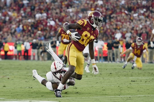 Sep 9, 2017; Los Angeles, CA, USA; Southern California Trojans wide receiver Deontay Burnett (80) runs the ball under pressure by Stanford Cardinal safety Justin Reid (8) during the second quarter at Los Angeles Memorial Coliseum. Mandatory Credit: Kelvin Kuo-USA TODAY Sports