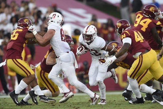 Sep 9, 2017; Los Angeles, CA, USA; Stanford Cardinal running back Cameron Scarlett (22) runs the ball against the Southern California Trojans during the second quarter at Los Angeles Memorial Coliseum. Mandatory Credit: Kelvin Kuo-USA TODAY Sports