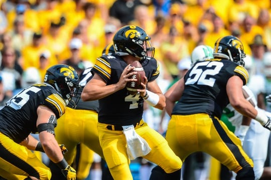 Sep 16, 2017; Iowa City, IA, USA; Iowa Hawkeyes quarterback Nathan Stanley (4) drops back to pass during the first quarter against the North Texas Mean Green at Kinnick Stadium. Mandatory Credit: Jeffrey Becker-USA TODAY Sports