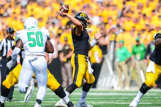 Sep 16, 2017; Iowa City, IA, USA; Iowa Hawkeyes quarterback Nathan Stanley (4) passes the ball as North Texas Mean Green defensive end LaDarius Hamilton (50) rushes in during the first quarter at Kinnick Stadium. Mandatory Credit: Jeffrey Becker-USA TODAY Sports