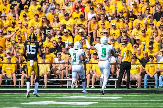Sep 16, 2017; Iowa City, IA, USA; North Texas Mean Green running back Jeffery Wilson (3) runs for a touchdown during the first quarter as wide receiver Jalen Guyton (9) looks on and Iowa Hawkeyes defensive back Joshua Jackson (15) chases from behind at Kinnick Stadium. Mandatory Credit: Jeffrey Becker-USA TODAY Sports
