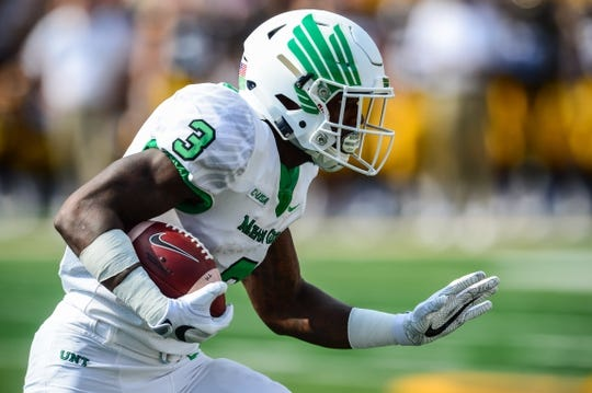 Sep 16, 2017; Iowa City, IA, USA; North Texas Mean Green running back Jeffery Wilson (3) runs the ball against the Iowa Hawkeyes during the first quarter at Kinnick Stadium. Mandatory Credit: Jeffrey Becker-USA TODAY Sports