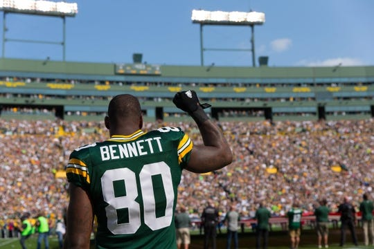 Sep 10, 2017; Green Bay, WI, USA; Green Bay Packers tight end Martellus Bennett (80) raises a fist during national anthem prior to the game against the Seattle Seahawks at Lambeau Field. Mandatory Credit: Jeff Hanisch-USA TODAY Sports