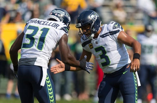 Sep 10, 2017; Green Bay, WI, USA; Seattle Seahawks quarterback Russell Wilson (3) and safety Kam Chancellor (31) during warmups prior to the game against the Green Bay Packers at Lambeau Field. Mandatory Credit: Jeff Hanisch-USA TODAY Sports
