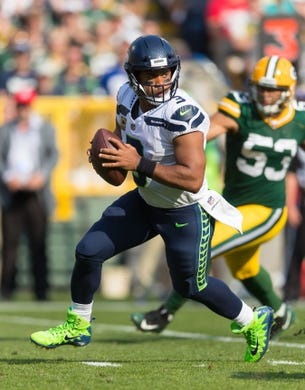 Sep 10, 2017; Green Bay, WI, USA; Seattle Seahawks quarterback Russell Wilson (3) during the game against the Green Bay Packers at Lambeau Field. Mandatory Credit: Jeff Hanisch-USA TODAY Sports