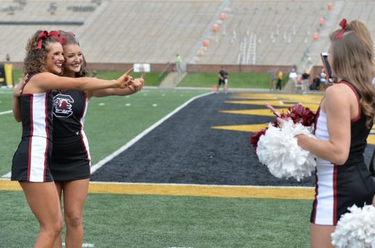 Sep 9, 2017; Columbia, MO, USA; South Carolina Gamecocks cheerleaders take selfies on field before the game against the Missouri Tigers at Faurot Field. Mandatory Credit: Denny Medley-USA TODAY Sports