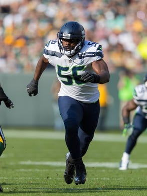 Sep 10, 2017; Green Bay, WI, USA; Seattle Seahawks defensive end Cliff Avril (56) during the game against the Green Bay Packers at Lambeau Field. Mandatory Credit: Jeff Hanisch-USA TODAY Sports