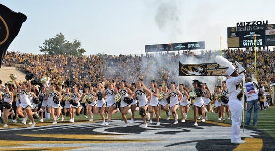 Sep 9, 2017; Columbia, MO, USA; Missouri Tigers cheerleaders run onto the field before the game against the South Carolina Gamecocks at Faurot Field. Mandatory Credit: Denny Medley-USA TODAY Sports