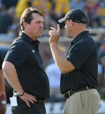 Sep 9, 2017; Columbia, MO, USA; South Carolina Gamecocks head coach Will Muschamp (left) and Missouri Tigers head coach Barry Odom talk before the game at Faurot Field. Mandatory Credit: Denny Medley-USA TODAY Sports