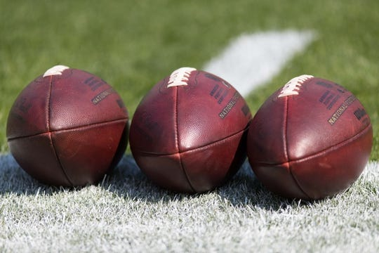Sep 10, 2017; Green Bay, WI, USA; NFL footballs sit on the sidelines during warmups prior to the game between the Seattle Seahawks and Green Bay Packers at Lambeau Field. Mandatory Credit: Jeff Hanisch-USA TODAY Sports