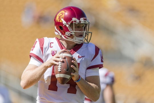 Sep 23, 2017; Berkeley, CA, USA; USC Trojans quarterback Sam Darnold (14) passes during warmups  before the game against the California Golden Bears at Memorial Stadium. Mandatory Credit: John Hefti-USA TODAY Sports